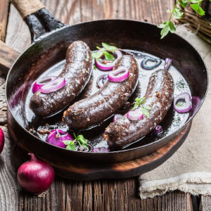 Tasty black pudding with onion and parsley